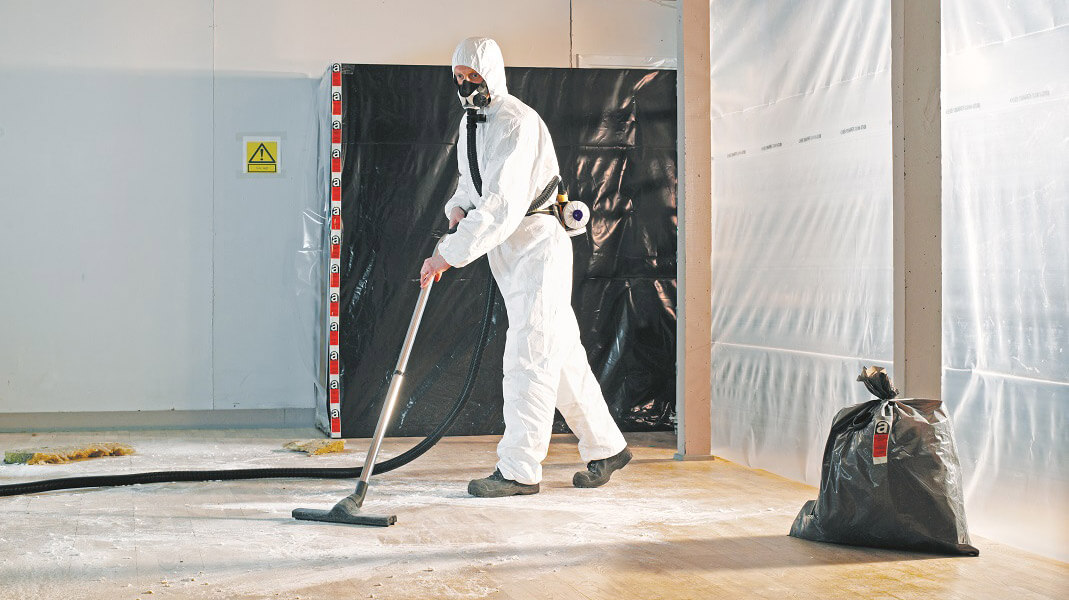 Special asbestos collection systems by Nilfisk captures the dangerous particles in a sealable bag for safe disposal